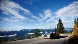 Participants in the Ennstal Classic oldtimer rally on the road up to mount Stoderzinken