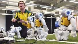 Soccer robots are prepared in Sydney yesterday.
