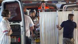 Medics evacuate an Israeli woman who was injured during a knife attack in the Jewish settlement of N