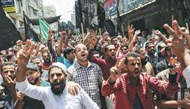 Palestinian protesters shout slogans during a gathering in the southern Gaza Strip city of Khan Yuni
