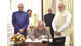 President Pranab Mukherjee signs the visitors book at Hyderabad House, during a farewell hosted by P