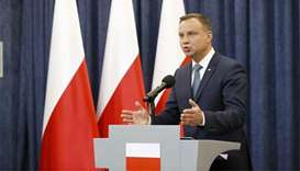 Poland's Duda blocks judiciary reforms after days of protests