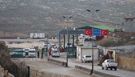 Syria's main crossing with Turkey reopens, monitor says