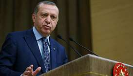 Turkish President Tayyip Erdogan addresses academics during a meeting at the Presidential Palace in