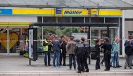 Police cordon off the area around a supermarket in the northern German city of Hamburg, where a man