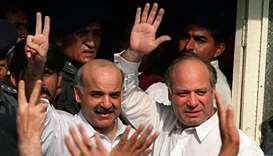 Deposed Pakistani Prime Minister Nawaz Sharif (R) and his brother Shahbaz Sharif (L) waving at suppo