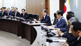 South Korean President Moon Jae-In (C) presides over an emergency meeting with National Security Cou