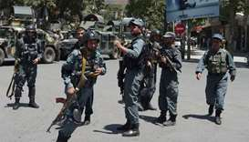 Afghan policemen arrive at the site of a suicide blast near Iraq's embassy in Kabul