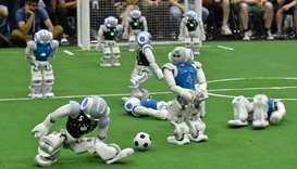 Robots fight for the ball during their football match in the standard platform league tournament