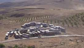buses that will transfer Nusra Front militants at an unidentified location at the Lebanese-Syrian bo