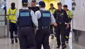 Police walk through the international terminal as they patrol Sydney Airport