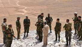 Forces inspect an area recently recaptured from IS group in Aleppo