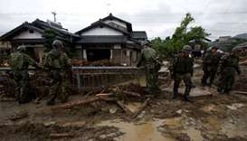 Japanese rescuers continue search as more rain forecast
