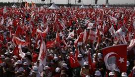 People wave Turkish flags during a rally to mark the end of the main opposition Republican People's