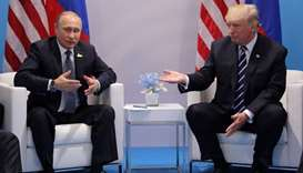 Russia's President Vladimir Putin talks to U.S. President Donald Trump during their bilateral meetin