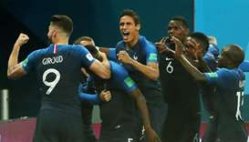 France's Samuel Umtiti celebrates with team mates after scoring their first goal
