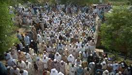 Pakistani residents offer funeral prayers for blast victims, who were killed in a suicide bombing at