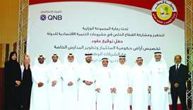 Al Hajri and senior Ministry officials are seen with the representatives of the wining companies