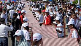 Cambodians roll out a 1,149.8 metre-long krama scarf so it can be declared as the world's longest ha