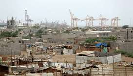 Hodeida port's cranes are pictured from a nearby shantytown in Hodeida. Reuters