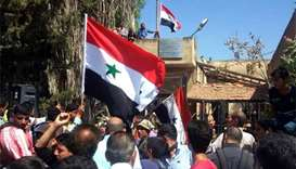 Syrian state raises flag in birthplace of revolt