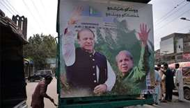 Pakistan ex-PM Sharif heads home to face jail before polls