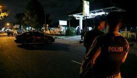 Indonesian police guard is seen near the scene of a shooting in Sleman, Yogyakarta, Indonesia