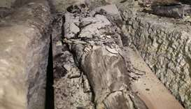 A mummy is seen inside the newly discovered burial site near Egypt's Saqqara necropolis, in Giza Egy