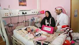 QRCS officials with a child patient.