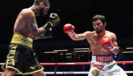 Philippines' Manny Pacquiao (R) fights Argentina's Lucas Matthysse during their world welterweight b