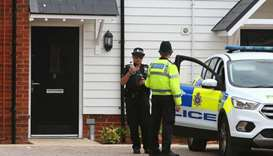 A police officer stands guard outside Charlie Rowley's house in Amesbury, southern England, on fourt