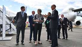 Theresa May (C) is accompanied by Airbus CEO Tom Enders (R) at the Farnborough Airshow