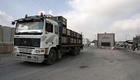 A truck is seen at the gate of the Kerem Shalom crossing