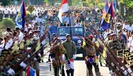 Dancing, military parade greet Asian Games flame in Indonesia