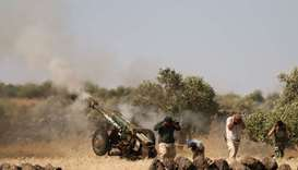 Syrian rebels fire artillery shells