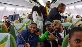Passengers pose for a selfie picture inside an Ethiopian Airlines flight