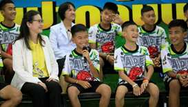 The 12 football players and their coach react as they explain their experience in the cave during th