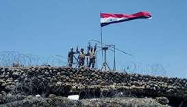 Syrian forces of President Bashar al Assad are seen celebrating on al-Haara hill in Quneitra area.