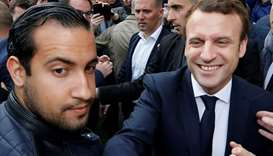 Emmanuel Macron (R) flanked by Alexandre Benalla (L) attends a campaign visit in Rodez,