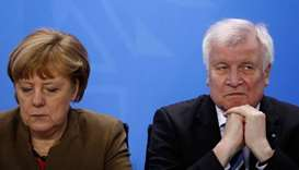 German Chancellor Angela Merkel (L) and German Interior Minister and leader of the CSU Party Horst S