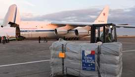 A forklift moves humanitarian supplies to be loaded onto Russian Antonov An-124 at at the former Cha