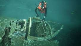 Divers explore the wreck of WWII fighter aircraft P47 Thunderbolt