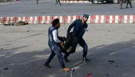 Members of Afghan security forces carry a wounded man at the site of a blast in Kabul. Reuters