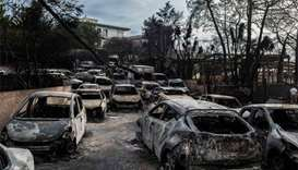 Wildfire kills 60 near Athens, flames trap families