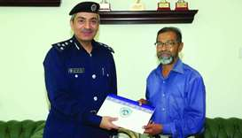 Brigadier Abdullah Khalifa al-Muftah hands over a token of appreciation to K M Abdul Sattar