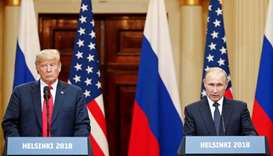 US President Donald Trump and Russian President Vladimir Putin hold a joint news conference after th
