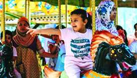 Young children enjoying the carousel.