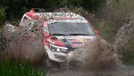 Toyota Hilux Qatari pilot Nasser Al Attiyah and French co-pilot Mathieu Baumel compete