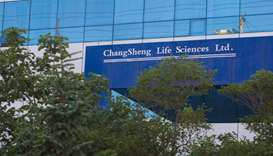A sign of vaccine maker Changsheng Bio-technology Co Ltd is pictured at its building in Changchun
