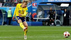 Fortunate Forsberg helps Sweden past Swiss into World Cup quarters